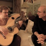john doan harp guitar retreat nick receives pointers from John Doan