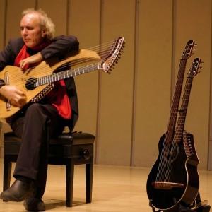 John Doan Xian China playing harp guitar on stage