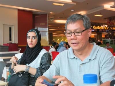 10. Joshua Tan and Woman Onlooking