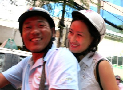 8. From Window of Cab Couple on Motorcycle