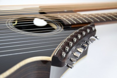 Brunner Harp Guitar from the Super Treble side revealing the upper sound port through the sound hole.