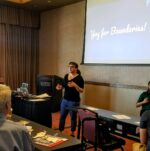 """Molly Adler presenting at a conference with """"boundaries"""" on screen behind her."""