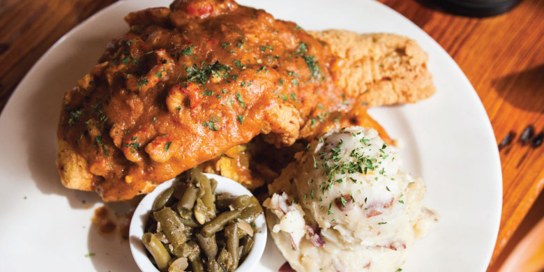 Crawfish Cornbread topped with Southern Fried Fish Filet