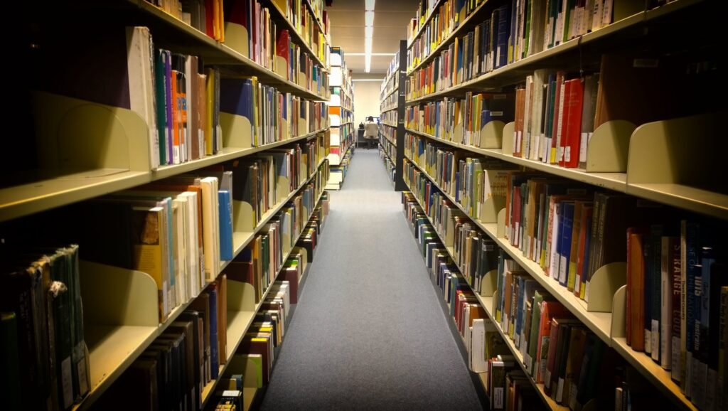 Library shelves stretching into the distance