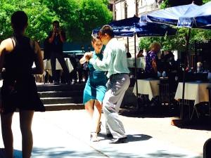 Tango dancers grace the sidewalks.