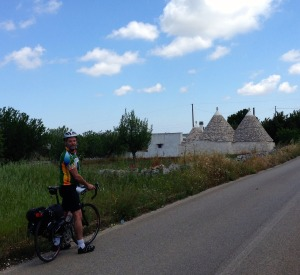Cycling in Alberello, known for its cone-shaped Trulli houses.