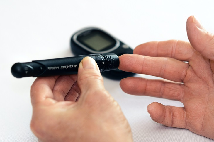 person with diabetes testing blood sugar