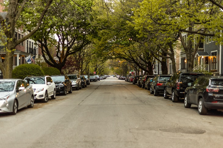 cars parking on side of city street