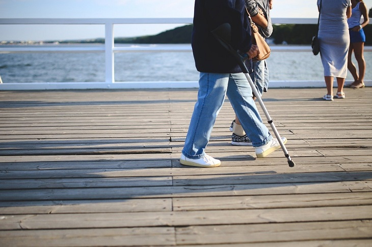 person walking with crutch