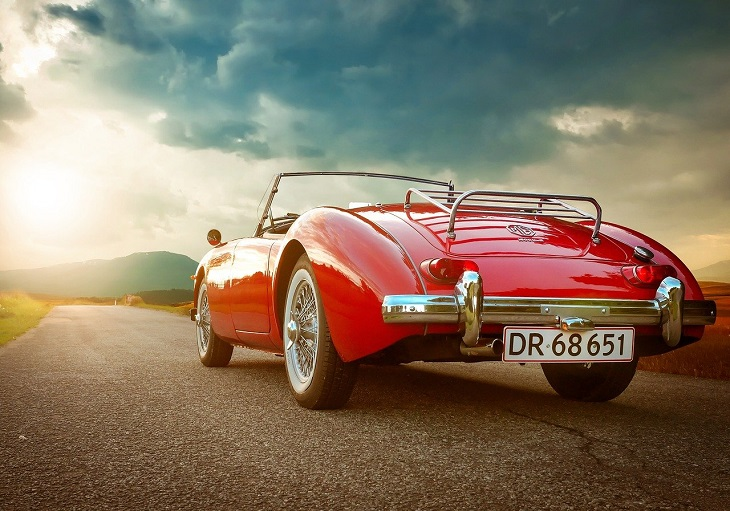 vintage car on the road in summer