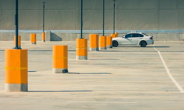 single car in parking lot
