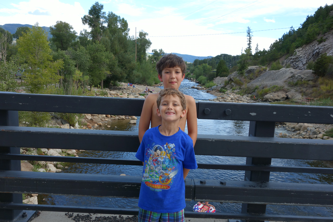 The boys standing over the Yampa River