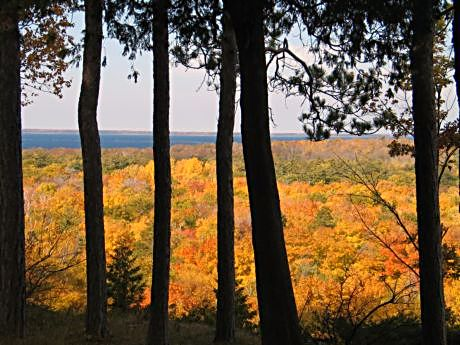 An overlook at Peninsula Park in Door County reveals warm tangerines, ambers and shimmering golds