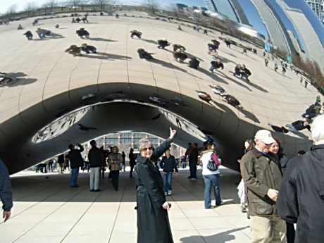 """A tourist notes the """"Bean"""" arch and reflections"""