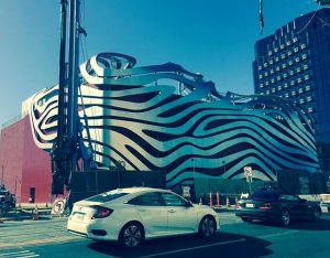 The recently redone Petersen Automotive Museum. A subway system is currently being extended just outside and below the museum.