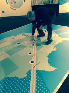 """At the Adler's """"Chasing Eclipses"""" exhibit, astronomer Larry Ciupik points out where Carbondale is on the 2017 eclipse path that goes from left to right. It is bisected by the eclipse path that will run from southeast to north west in 2024."""