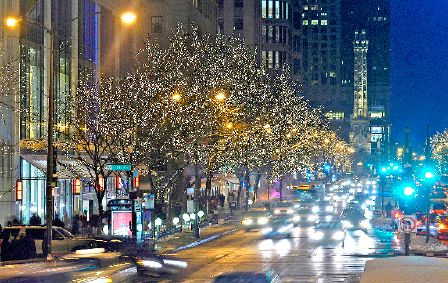 North Michigan Avenues Magnificent Mile twinkles after the Mickey and Minnie Mouse parade flicks the lights switch (City of Chicago photo)