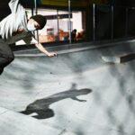 Skateboarder shredding with a face mask