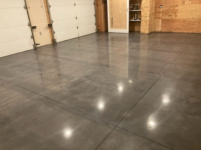 This garage in Weare, New Hampshire before and after photos. With new concrete, it is important that the slab is properly finished. Otherwise, it will result in additional time and charges. Also added guard and burnished.