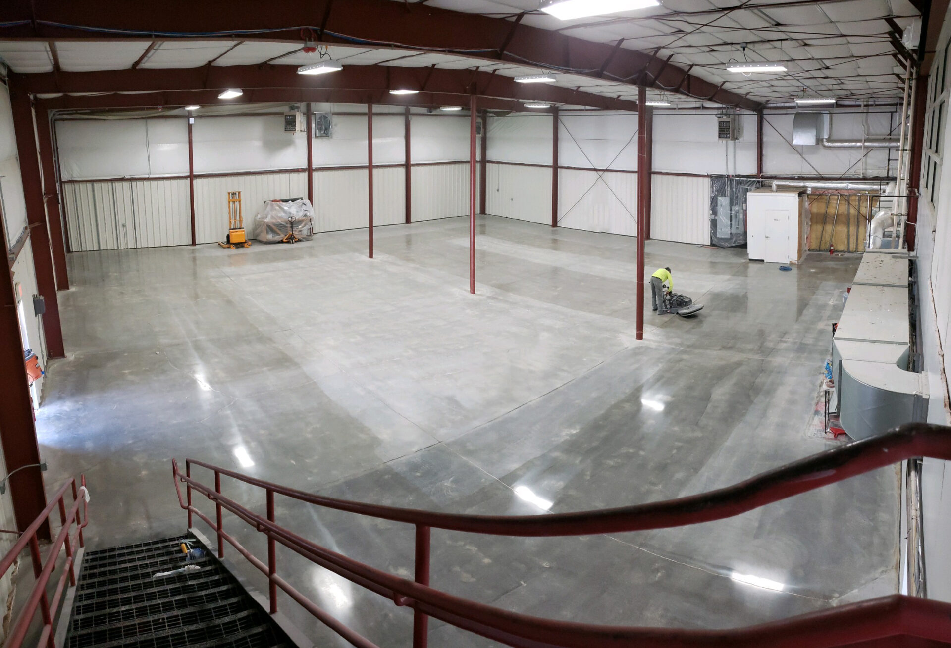 Storage units in Manchester, VT. The entire slab was ground, honed, densified, and polished to 400 grit finish. The owner asked for the aisles to be shiny and more reflective. The aisles between the individual storage units were guarded and burnished to 800 grit