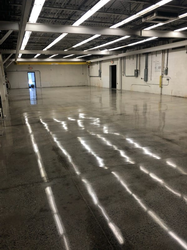 10,000 square foot industrial space. The floors of this Machine Shop had many layers of epoxy and paint. This is a common practice as epoxy and paint are applied over the previous layers. (Maybe we include, why a machine shop benefits from a polished floor. Why is it worth getting it done. This could be a few sentences or longer for a more detailed post that I can link back to) When we got down to the bare floor, we were able to give it a full warehouse polish and burnish. A 40,000 sq ft building (we did 10K) and grew over the years. The floors had a few levels of epoxy and paint which is typical since people just kept painting over the floor. We scrapped and ground down the paint and epoxy.