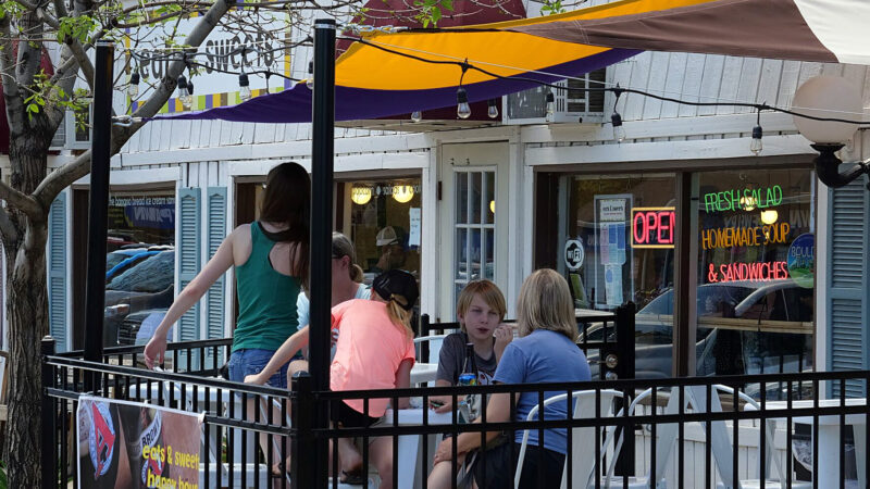 A family dines alfresco at a cafe in Old Town Lafayette, near Cannon Trail, which was built on an infill parcel.