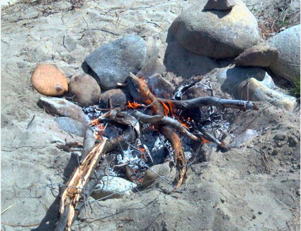 Build an Oak wood fire atop the flat rocks & let it burn down to coals to cover the entire pit.