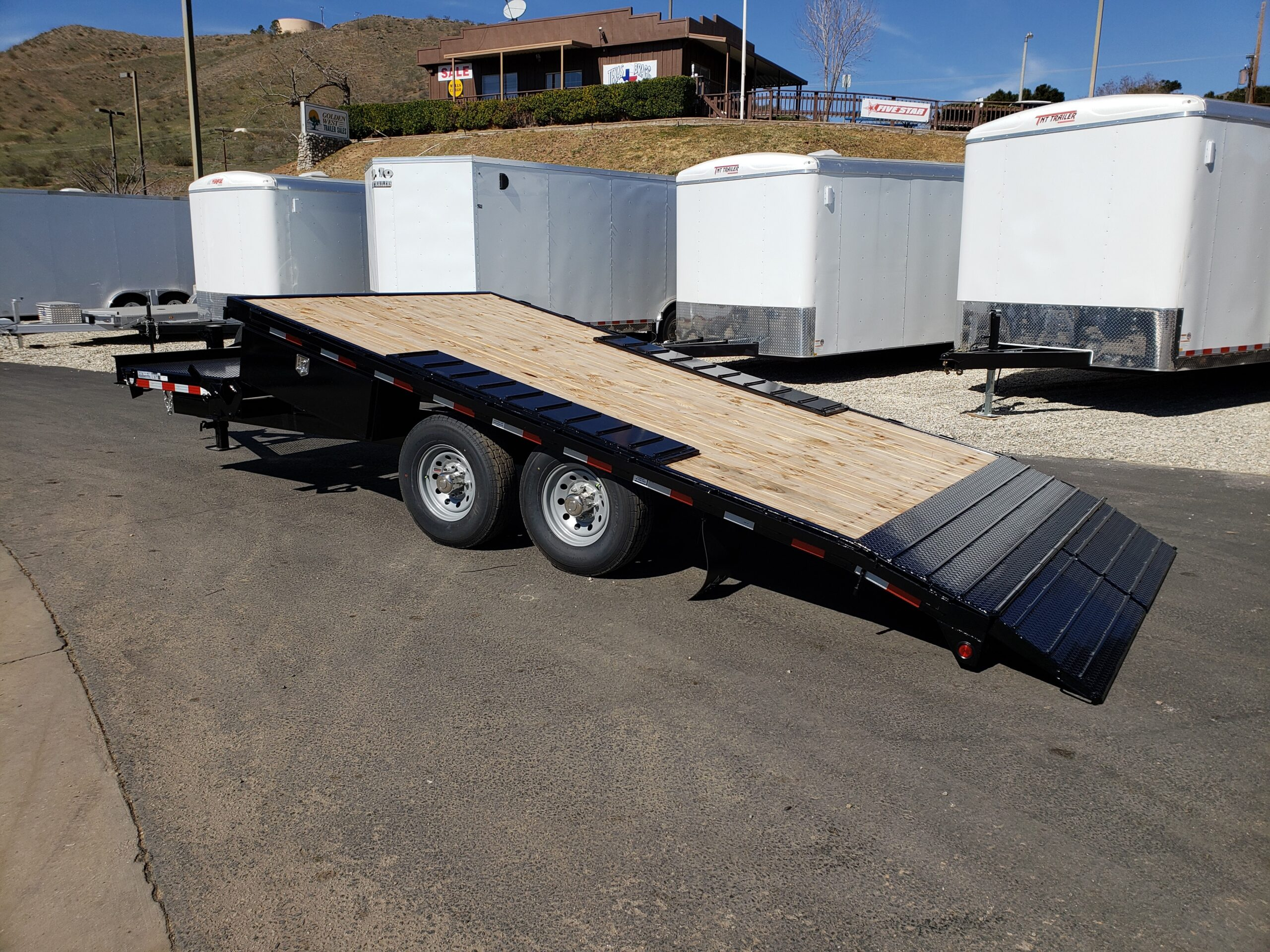 Snake River 20ft OTW Tilt - Driver side rear 3/4 view bed tilted