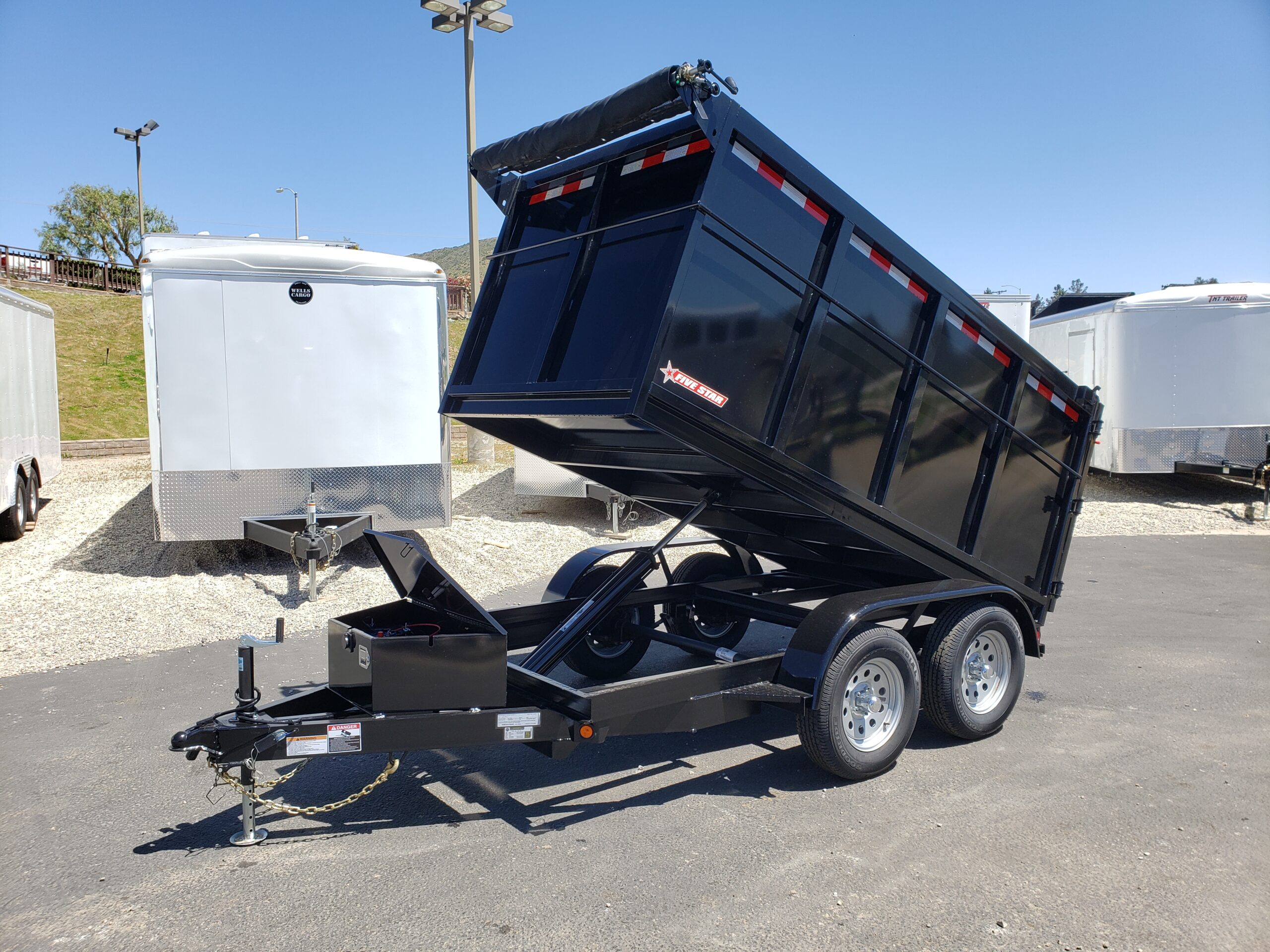 Five Star 5x10 7K Dump 4ft - Driver side front 3/4 view bed dumped