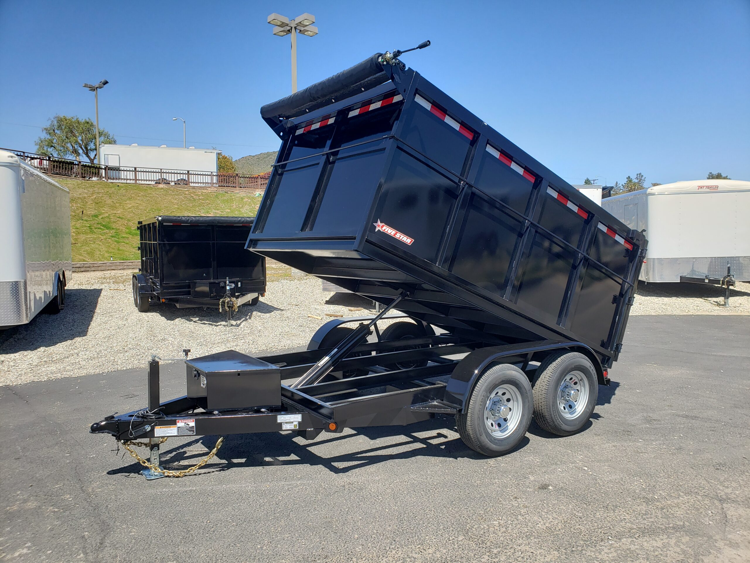 Five Star 6.5x10 10k Dump4ft - Driver side front 3/4 view bed dumped