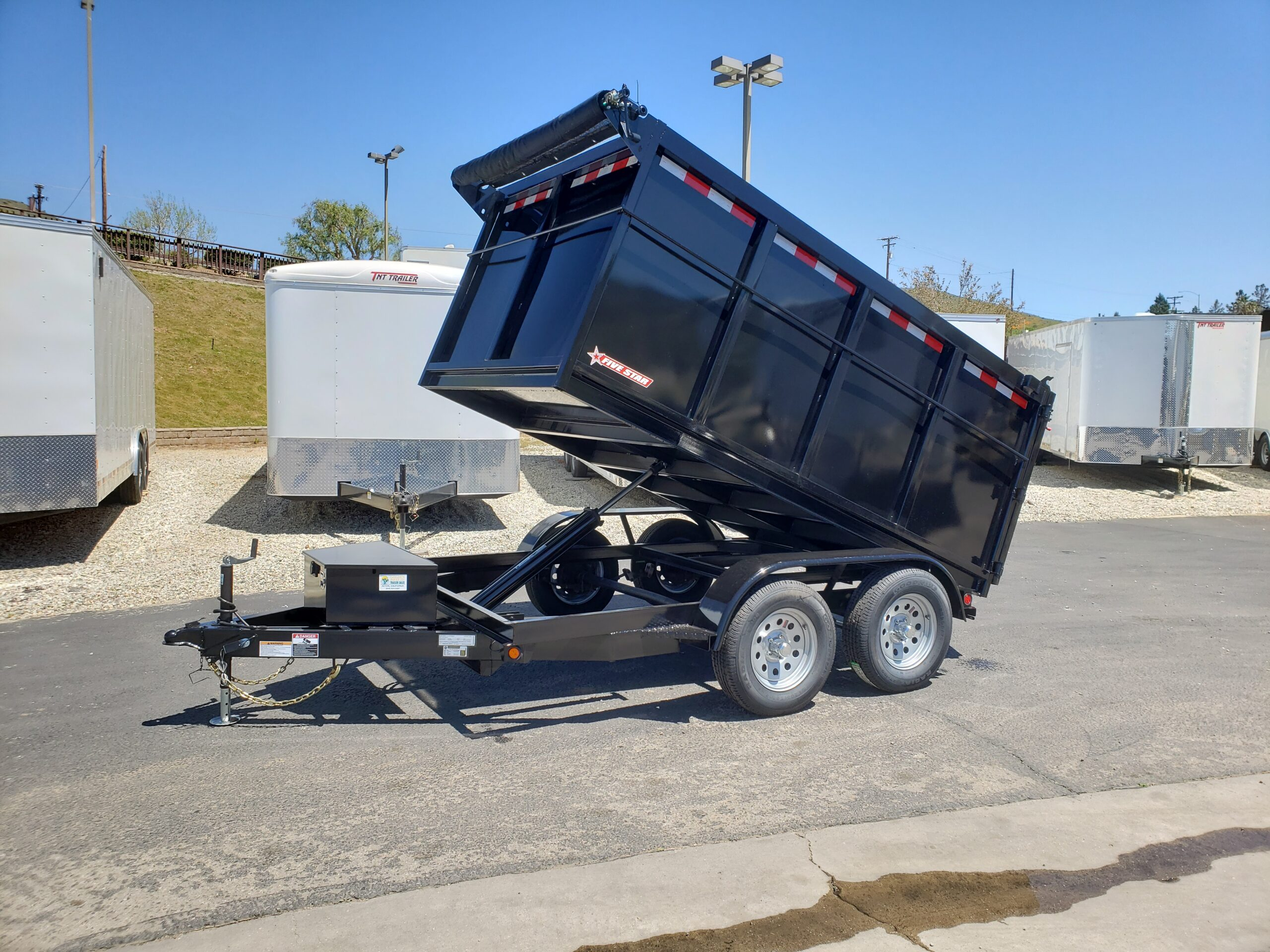 Five Star 6.5x10 7k Dump4ft - Driver side front 3/4 view bed dumped