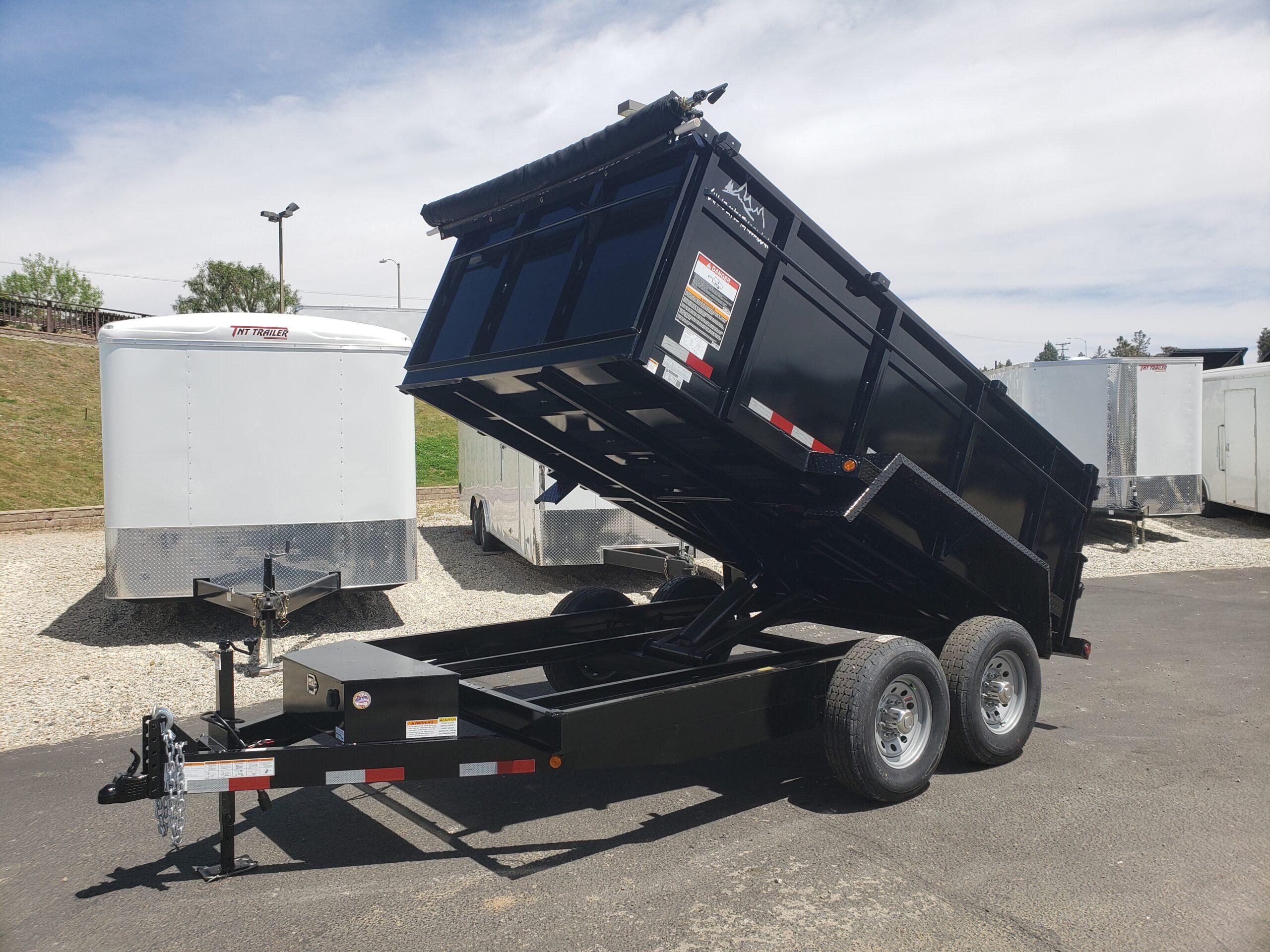 Snake River 7x12 Dump 3ft - Driver side front 3/4 view bed dumped