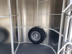 Maverick 3-H Highside SRD - Closeup of tack room showing blanket bars & mounted spare
