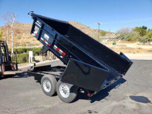 Snake River 7x12 Dump 2ft/14 - Driver side rear 3/4 view bed dumped
