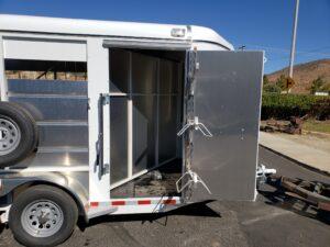 Maverick 13' 2-Horse - View of tack room door open w/saddle rack