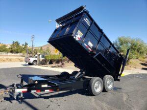 Snake River 7x12 Dump 4ft - Driver side front 3/4 view bed dumped