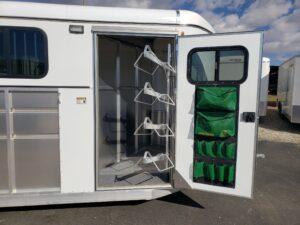 Maverick Lite 4-Horse Dlx - Looking into tack room door showing saddle rack