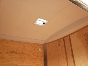 Showing lined ceiling and vent from side door