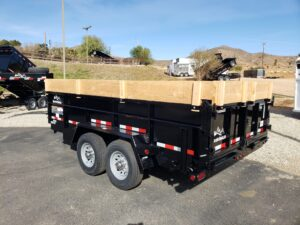 Snake River 7x14 Dump 2ft/SG - Driver side rear 3/4 view w/wood extensions