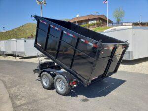 Five Star 6.5x10 7k Dump4ft - Driver side rear 3/4 view bed dumped