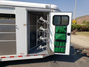 Maverick 4-Horse Highside - View of tack room door open with saddle rack swung out