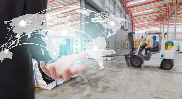 business person holding virtual map inside warehouse facility