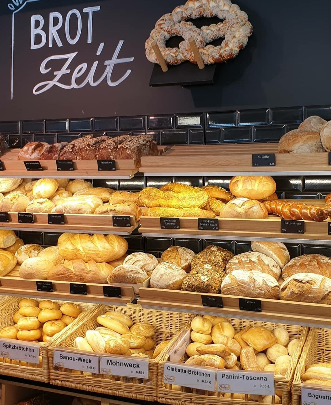 Shelfs with bread loaves and rolls in a German bakery