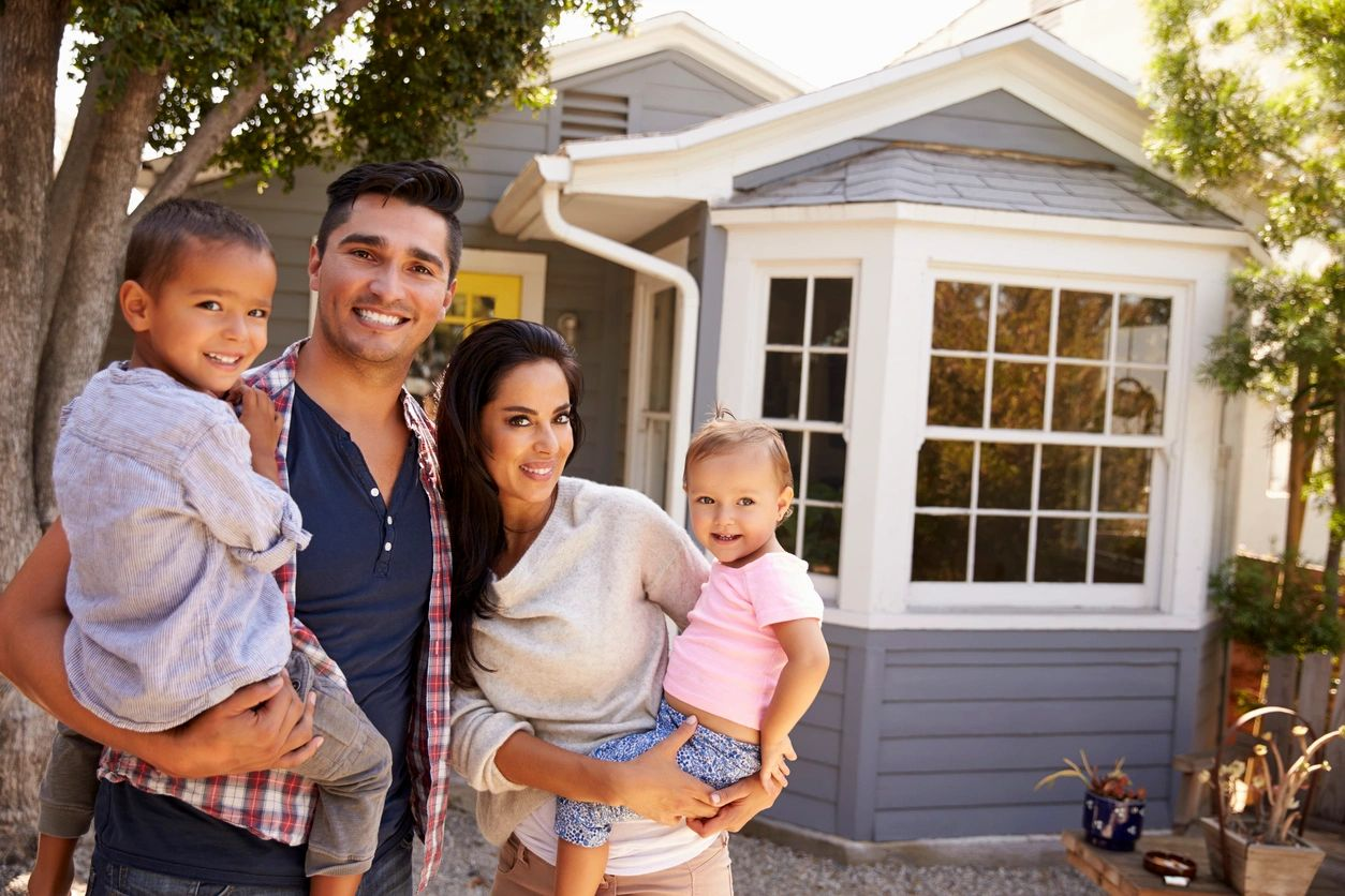 Realtor® Yakima Washington Homes Family standing in front of their house with kids smiling at the camera