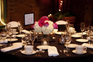 Hot pink gerbera daisy and roses with white hydrangea centerpiece
