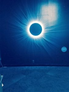 A simulator at the exhibit lets visitors experience an eclipse next to what appears to be a black hole in the sky. Photo by Jodie Jacobs