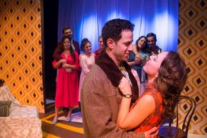 """Dan Gold (Vernon) and Carmen Risi (Sonia) and company in """"They're Playing Our Song."""" A Brown Paper Box Co. photo"""