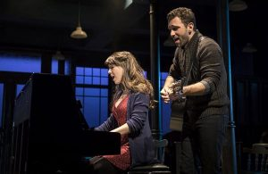 """Tiffany Topol (Girl) and Barry DeBois (Guy) perform the Oscar-winning song """"Falling Slowly"""" in Once, at the Paramount Theatre in Aurora. (Liz Lauren photos)"""