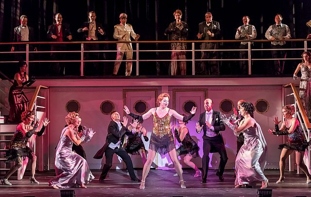 Erica Evans, c, and ensemble in 'Anything Goes' at Music Theater Works in Cahn Auditorium. (Photo by Brett Beiner)