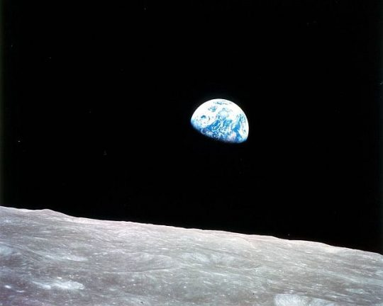 Earth Rising over the Moon's Horizon This view of Earth rising over the Moon's horizon was taken from the Apollo 11 spacecraft. The lunar terrain pictured is in the area of Smyth's Sea on the nearside. (Photo courtesy of NASA)